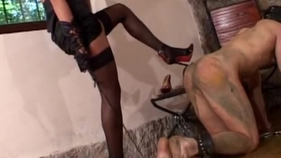 Cuffed slave gets smeared out slapped & cleans mistress' dirty shoes