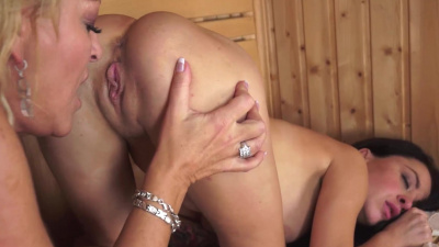 Old-Young lesbian couple lick each other's clits in a sauna