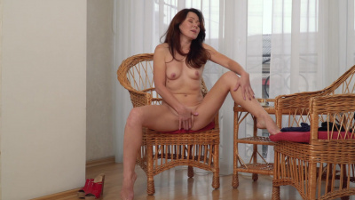 Delicate housewife Ptica masturbates on a chair