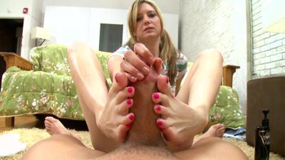 Kacey Jones tugging cock with her feet